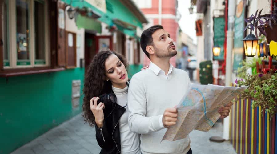 Tourist couple searching for destination