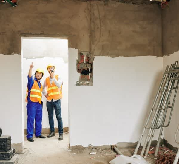 Builder showing room to contractor